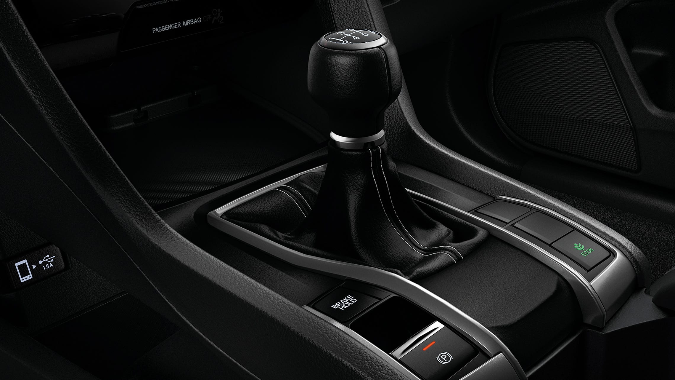 6-speed manual transmission shifter detail in the 2021 Honda Civic Sport Hatchback.
