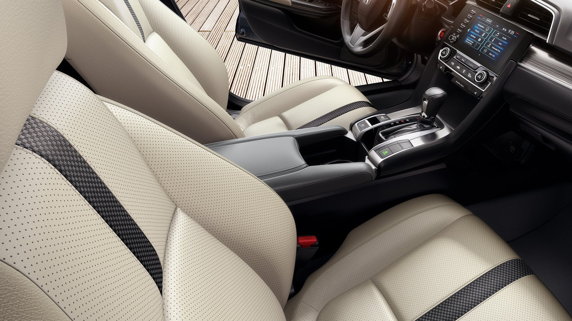 Interior passenger-side view of front seats in the 2021 Honda Civic Touring Sedan with Ivory Leather.