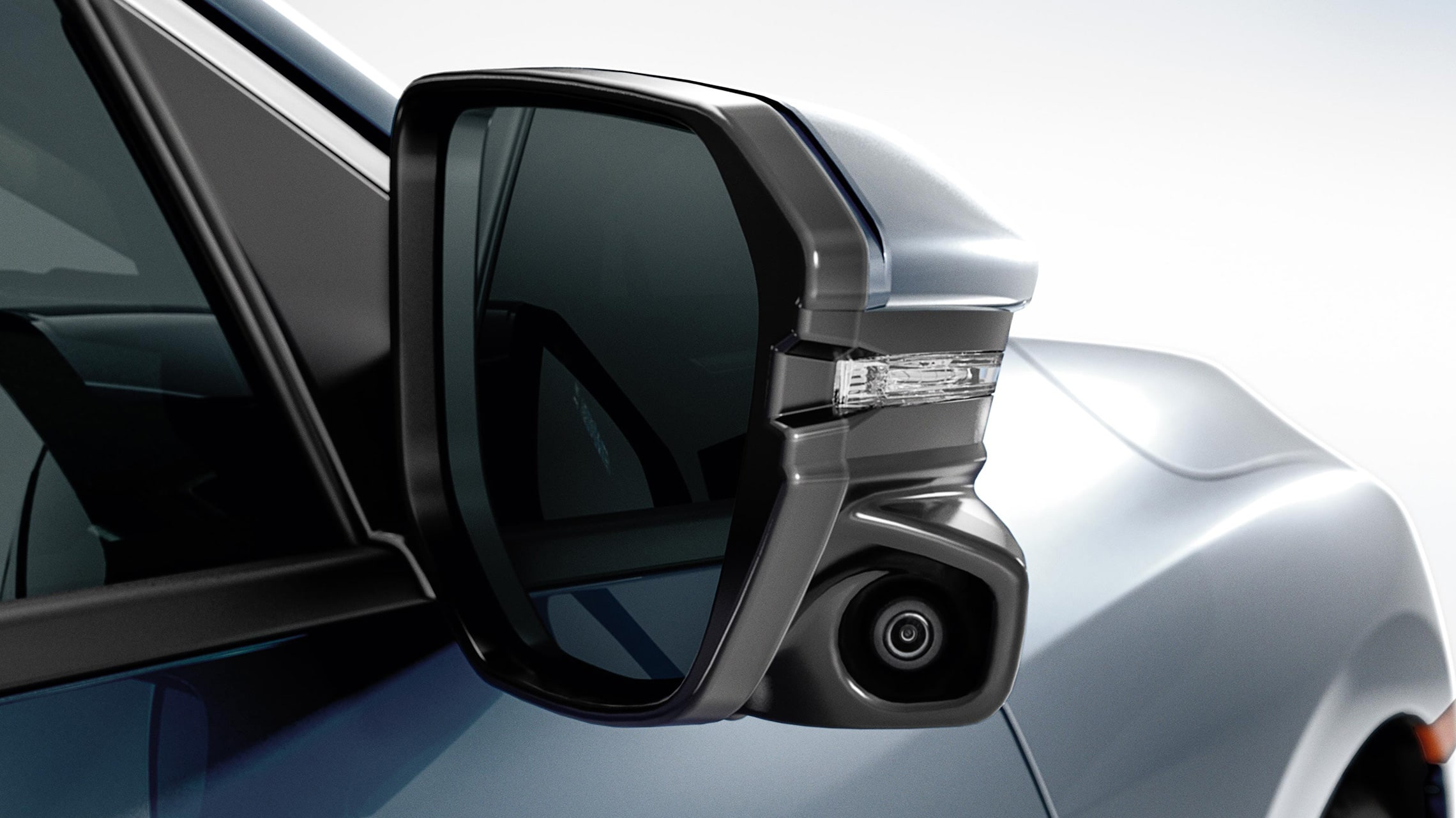 Honda LaneWatch™ camera detail on passenger-side mirror on the 2021 Honda Civic Touring Sedan in Cosmic Blue Metallic.